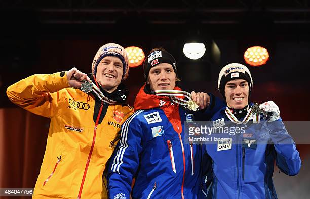 Gold medallist Rune Velta of Norway poses with silver medallist Severin Freund of Germany and bronze medallist Stefan Kraft of Austria during the...