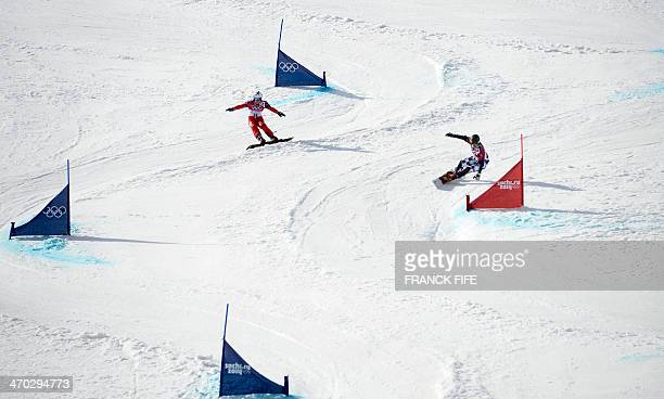 Gold Medallist Russia's Vic Wild and Silver Medallist Switzerland's Nevin Galmarini compete in the Men's Snowboard Parallel Giant Slalom Final at the...