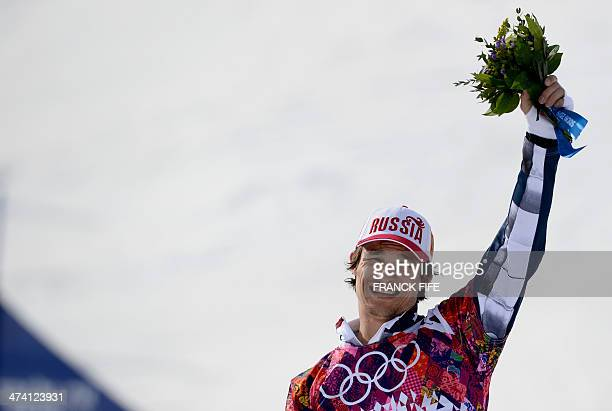 Gold Medallist Russia's Vic Wild celebrates at the Men's Snowboard Parallel Slalom Flower Ceremony at the Rosa Khutor Extreme Park during the Sochi...