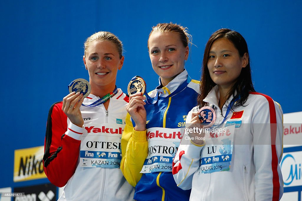Gold medallist <a gi-track='captionPersonalityLinkClicked' href=/galleries/search?phrase=Sarah+Sjostrom&family=editorial&specificpeople=6000292 ng-click='$event.stopPropagation()'>Sarah Sjostrom</a> of Sweden poses with silver medallist Jeanette Ottesen of Denmark and bronze medallist Ying Lu of China during the medal ceremony for the Women's 50m Butterfly Final on day fifteen of the 16th FINA World Championships at the Kazan Arena on August 8, 2015 in Kazan, Russia.