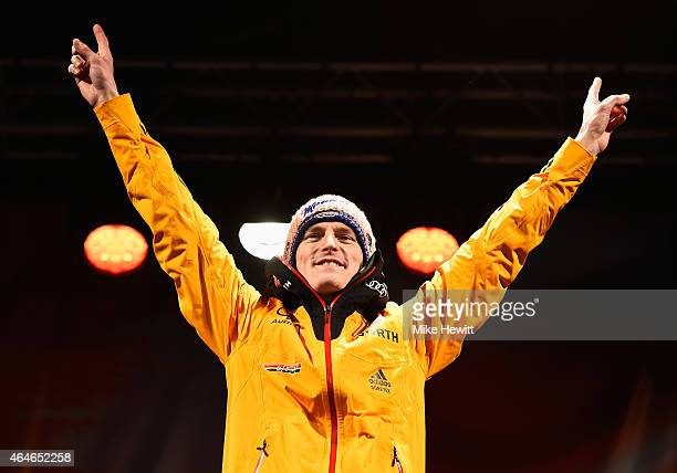 Gold medallist Severin Freund of Germany celebrates during the medal ceremony for the Men's HS134 Large Hill Ski Jumping Final during the FIS Nordic...