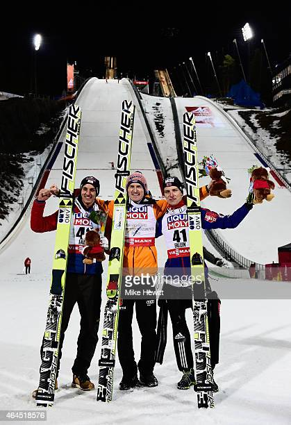 Gold medallist Severin Freund of Germany poses with silver medallist Gregor Schlierenzauer of Austria and bronze medallist Rune Velta of Norway after...