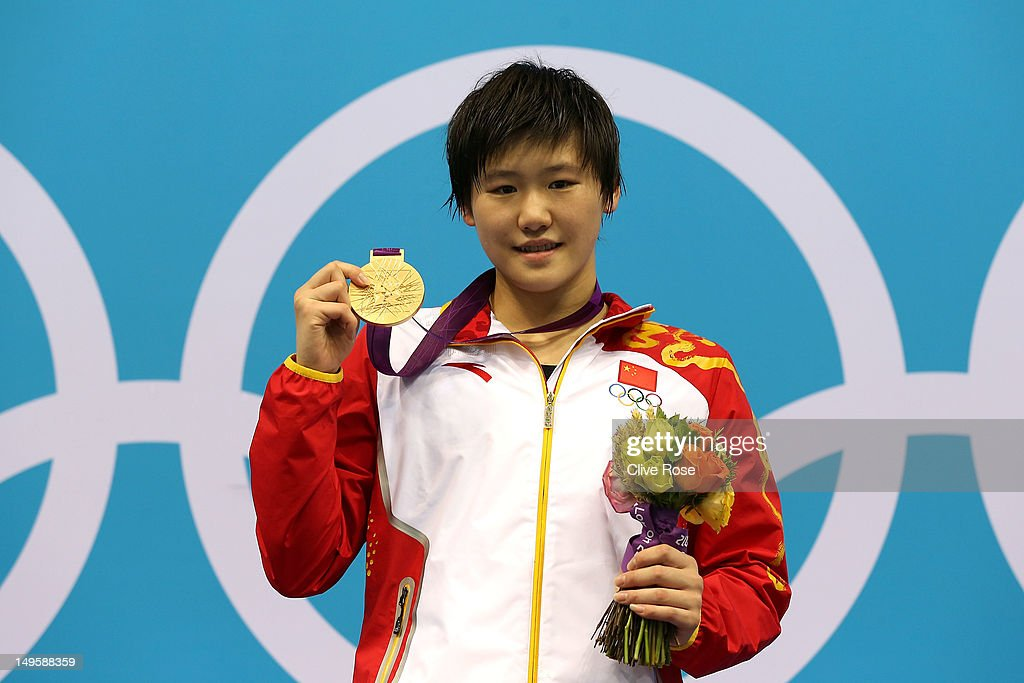 Gold medallist Shiwen Ye of China poses on the podium during the medal ceremony in the Women's 200m Individual Medley final on Day 4 of the London 2012 Olympic Games at the Aquatics Centre on July 31, 2012 in London, England.