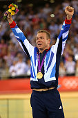 Gold medallist Sir Chris Hoy of Great Britain celebrates during the medal ceremony for the Men's Keirin Track Cycling Final on Day 11 of the London...