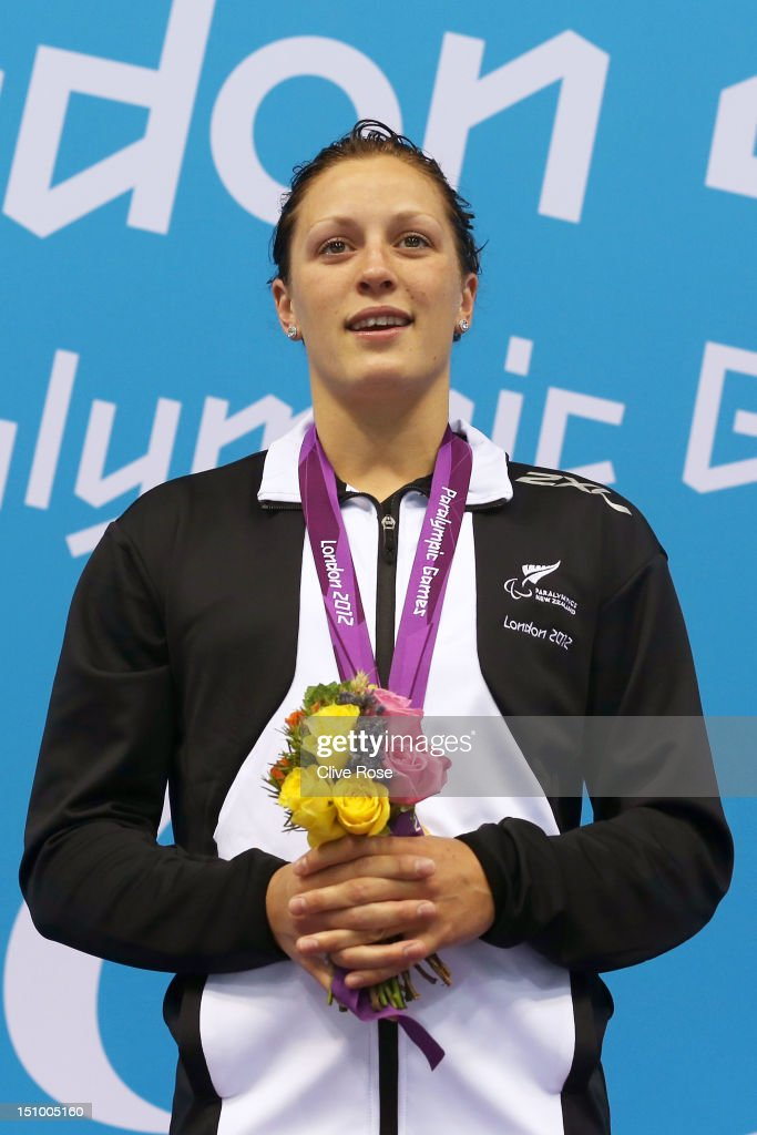 Gold medallist Sophie Pascoe of New Zealand poses on the podium during the medal ceremony for the Women's 200m Individual Medley - SM10 final on day 1 of the London 2012 Paralympic Games at Aquatics Centre on August 30, 2012 in London, England.