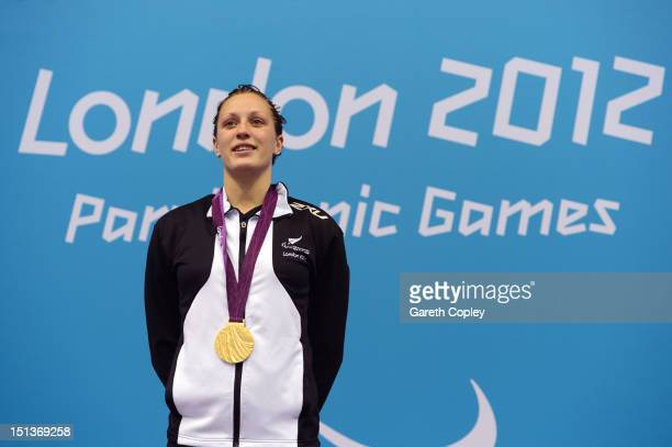 Gold medallist Sophie Pascoe of New Zealand poses on the podium during the medal ceremony for the Women's 100m Freestyle S10 final on day 8 of the...
