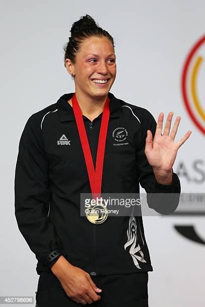 Gold medallist Sophie Pascoe of New Zealand waves during the medal ceremony for the Women's 100m Breaststroke SB9 Final at Tollcross International...