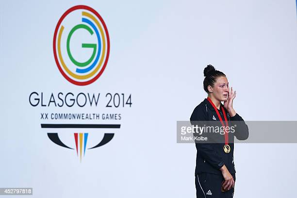 Gold medallist Sophie Pascoe of New Zealand wipes away tears during the medal ceremony for the Women's 100m Breaststroke SB9 Final at Tollcross...