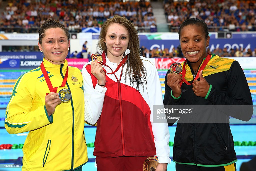 Gold medallist Sophie Taylor of England poses with silver medallist <a gi-track='captionPersonalityLinkClicked' href=/galleries/search?phrase=Lorna+Tonks&family=editorial&specificpeople=9060731 ng-click='$event.stopPropagation()'>Lorna Tonks</a> of Australia and bronze medallist <a gi-track='captionPersonalityLinkClicked' href=/galleries/search?phrase=Alia+Atkinson&family=editorial&specificpeople=881789 ng-click='$event.stopPropagation()'>Alia Atkinson</a> of Jamaica after the medal ceremony for the Women's 100m Breaststroke Final at Tollcross International Swimming Centre during day five of the Glasgow 2014 Commonwealth Games on July 28, 2014 in Glasgow, Scotland.