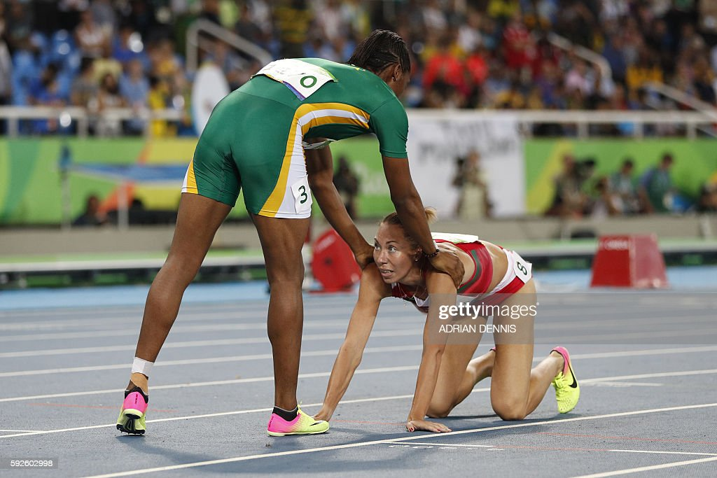 Gold medallist South Africa's Caster Semenya (L) congratulates Belarus' Marina Arzamasova after the Women's 800m Final during the athletics event at the Rio 2016 Olympic Games at the Olympic Stadium in Rio de Janeiro on August 20, 2016. / AFP / Adrian DENNIS