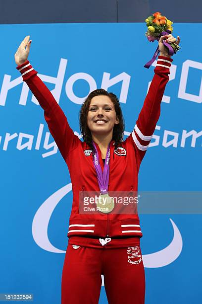 Gold medallist Summer Ashley Mortimer of Canada poses on the podium during the medal ceremony for the Women's 100m Backstroke S10 final on day 6 of...