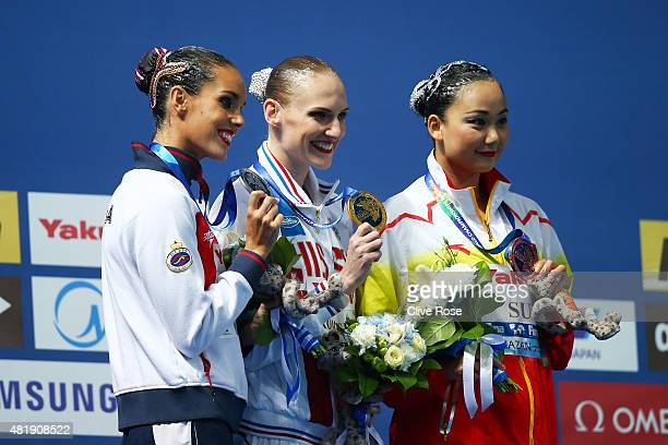 Gold medallist Svetlana Romashina of Russia poses with silver medallist Ona Carbonell of Spain and bronze medallist Wenyan Sun of China during the...