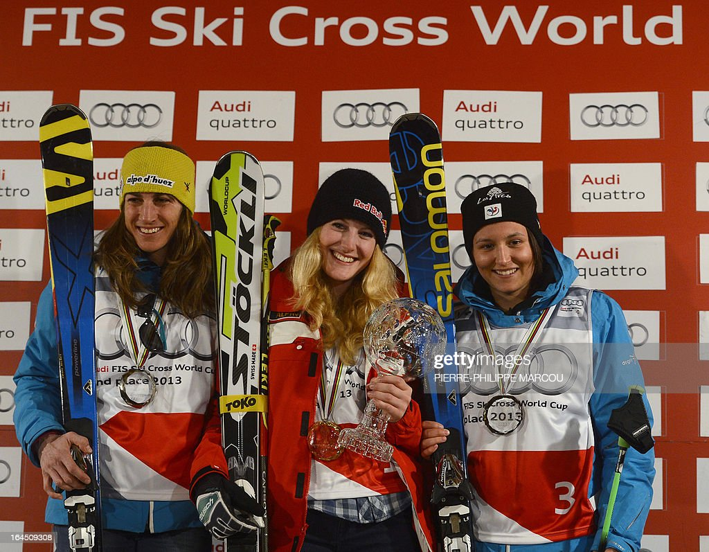 Gold medallist Swiss snowboarder Fanny Smith (C) poses with silver medalist French snowboarder Ophelie David (L) and bronze medalist French snowboarder Marielle Berger Sabbatel on the podium of the Ladies' Skicross World Cup standings during the World Cup Super finals Snowboard and FreeStyle at Sierra Nevada ski resort near Granada on March 24, 2013.