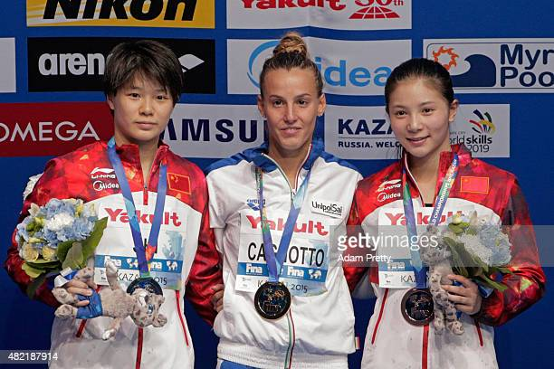 Gold medallist Tania Cagnotto of Italy poses with silver medallist Tingmao Shi of China and bronze medallist Zi He of China during the medal ceremony...