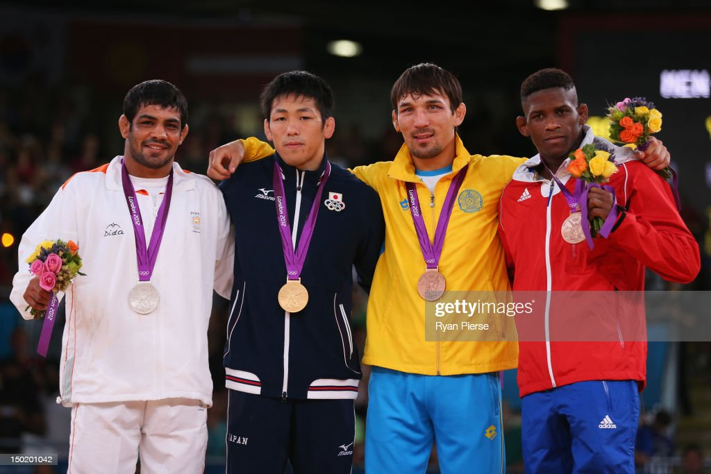 Gold medallist <a gi-track='captionPersonalityLinkClicked' href=/galleries/search?phrase=Tatsuhiro+Yonemitsu&family=editorial&specificpeople=7359200 ng-click='$event.stopPropagation()'>Tatsuhiro Yonemitsu</a> (2nd L) of Japan, silver medallist <a gi-track='captionPersonalityLinkClicked' href=/galleries/search?phrase=Sushil+Kumar&family=editorial&specificpeople=703954 ng-click='$event.stopPropagation()'>Sushil Kumar</a> (L) of India, bronze medallists Akzhurek Tanatarov of Kazakhstan and Livan Lopez Azcuy (R) of Cuba celebrate with their medals during the medal ceremony following the Men's Freestyle 66 kg Wrestling gold medal fight on Day 16 of the London 2012 Olympic Games at ExCeL on August 12, 2012 in London, England.