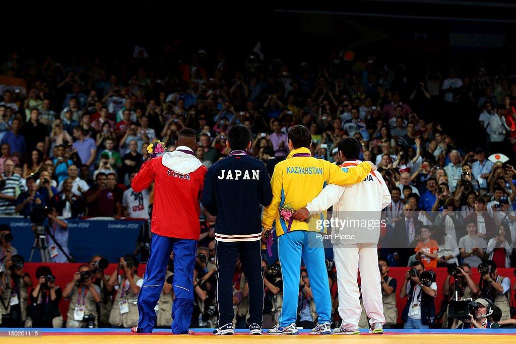 Gold medallist Tatsuhiro Yonemitsu of Japan silver medallist Sushil Kumar of India bronze medallists Akzhurek Tanatarov of Kazakhstan and Livan Lopez...