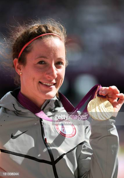 Gold medallist Tatyana Mcfadden of the United States poses on the podium during the medal ceremony for the Women's 800m T54 Final on day 8 of the...