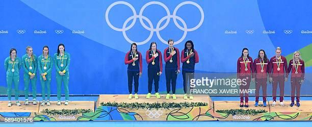US gold medallist team Kathleen Baker Lilly King Dana Vollmer Simone Manuel Australia's silver medallist team Emily Seebohm Taylor McKeown Emma...