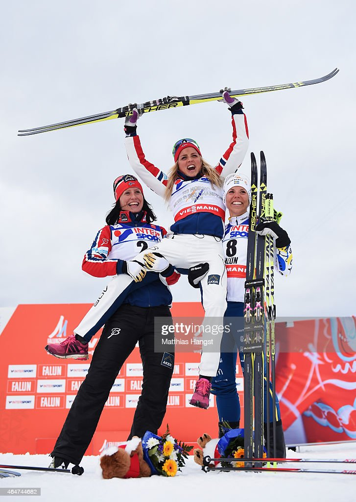 Gold medallist Therese Johaug of Norway celebrates with silver medallist Marit Bjoergen (L) of Norway and bronze medallist Charlotte Kalla of Sweden after the Women's 30km Mass Start Cross-Country during the FIS Nordic World Ski Championships at the Lugnet venue on February 28, 2015 in Falun, Sweden.