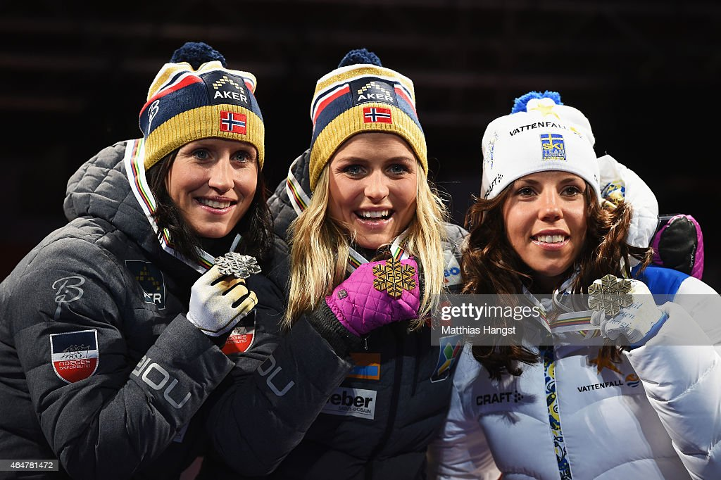 Gold medallist <a gi-track='captionPersonalityLinkClicked' href=/galleries/search?phrase=Therese+Johaug&family=editorial&specificpeople=4176080 ng-click='$event.stopPropagation()'>Therese Johaug</a> of Norway poses with silver medallist <a gi-track='captionPersonalityLinkClicked' href=/galleries/search?phrase=Marit+Bjoergen&family=editorial&specificpeople=216406 ng-click='$event.stopPropagation()'>Marit Bjoergen</a> (L) of Norway and bronze medallist <a gi-track='captionPersonalityLinkClicked' href=/galleries/search?phrase=Charlotte+Kalla&family=editorial&specificpeople=4081474 ng-click='$event.stopPropagation()'>Charlotte Kalla</a> of Sweden during the medal ceremony for the Women's 30km Mass Start Cross-Country during the FIS Nordic World Ski Championships at the Lugnet venue on February 28, 2015 in Falun, Sweden.