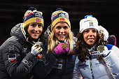 Gold medallist Therese Johaug of Norway poses with silver medallist Marit Bjoergen of Norway and bronze medallist Charlotte Kalla of Sweden during...