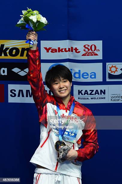 Gold medallist Tingmao Shi of China celebrates during the medal ceremony for the Women's 3m Springboard Diving Final on day eight of the 16th FINA...