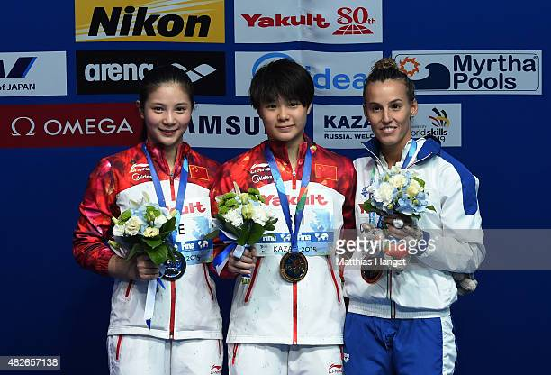 Gold medallist Tingmao Shi of China poses with silver medallist Zi He of China and bronze medallist Tania Cagnotto of Italy during the medal ceremony...