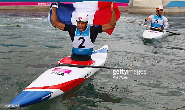 Gold medallist Tony Estanguet of France celebrates alongside silver medallist Sideris Tasiadis of Germany after competing in the Men's Canoe Single...