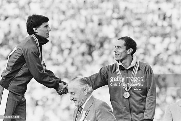 Gold medallist track athlete Sebastian Coe and bronze medallist Steve Ovett both of the Great Britain team shake hands during the medal ceremony for...