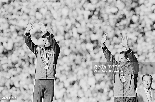 Gold medallist track athlete Sebastian Coe and bronze medallist Steve Ovett both of the Great Britain team pictured together waving to the crowd from...