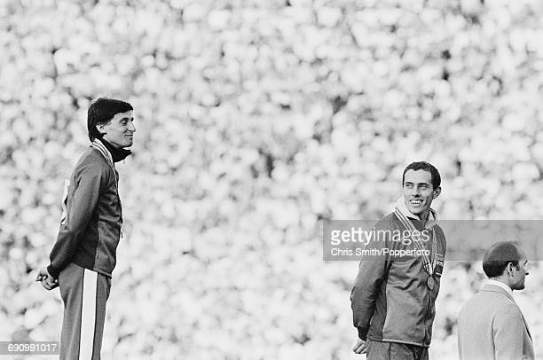 Gold medallist track athlete Sebastian Coe and bronze medallist Steve Ovett both of the Great Britain team pictured together on the medal podium...