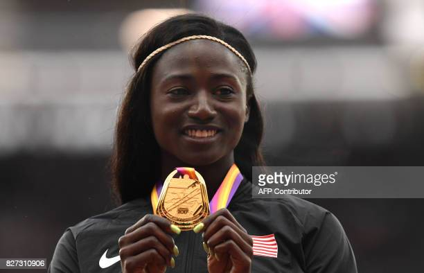 Gold medallist US athlete Tori Bowie poses on the podium during the victory ceremony for the women's 100m athletics event at the 2017 IAAF World...