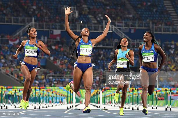 TOPSHOT Gold medallist USA's Brianna Rollins celebrates as she crosses the finish line ahead of silver medallist USA's Nia Ali and bronze medallist...