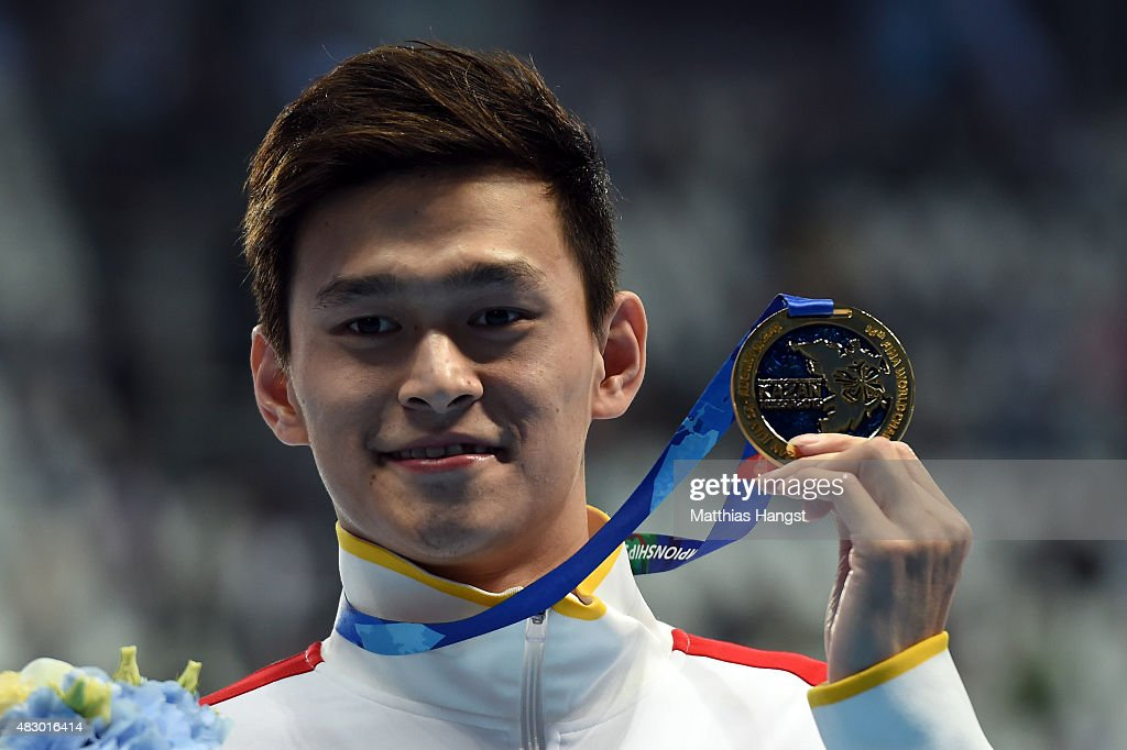 Gold medallist Yang Sun of China poses during the medal ceremony for the Men's 800m Freestyle Final on day twelve of the 16th FINA World Championships at the Kazan Arena on August 5, 2015 in Kazan, Russia.