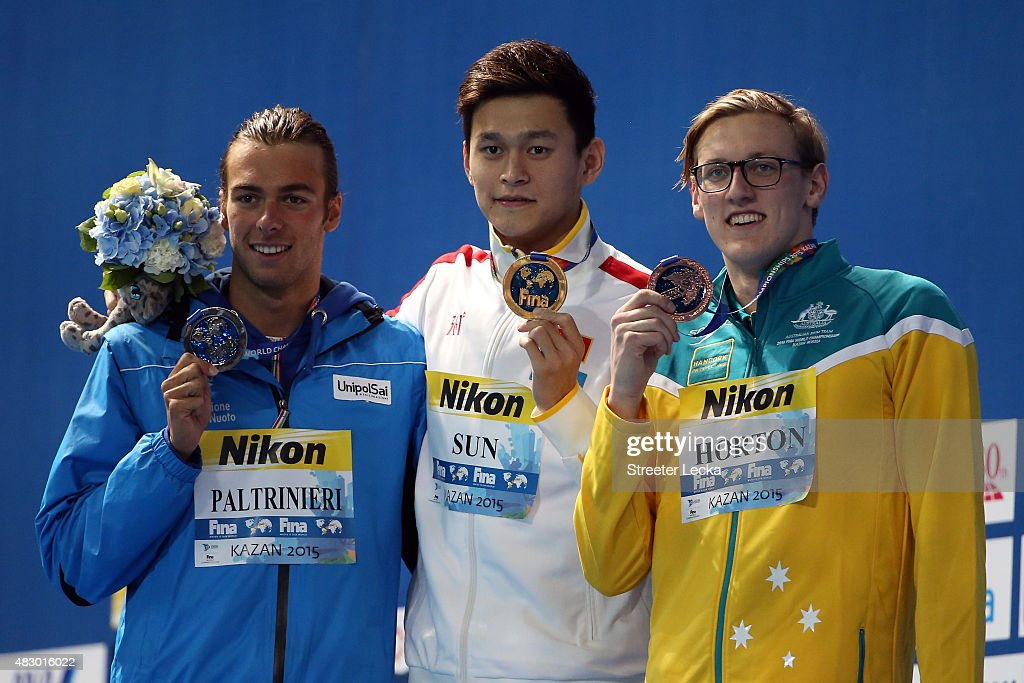 Gold medallist Yang Sun of China poses with silver medallist <a gi-track='captionPersonalityLinkClicked' href=/galleries/search?phrase=Gregorio+Paltrinieri&family=editorial&specificpeople=9426596 ng-click='$event.stopPropagation()'>Gregorio Paltrinieri</a> of Italy and bronze medallist <a gi-track='captionPersonalityLinkClicked' href=/galleries/search?phrase=Mack+Horton&family=editorial&specificpeople=9061058 ng-click='$event.stopPropagation()'>Mack Horton</a> of Australia during the medal ceremony for the Men's 800m Freestyle Final on day twelve of the 16th FINA World Championships at the Kazan Arena on August 5, 2015 in Kazan, Russia.