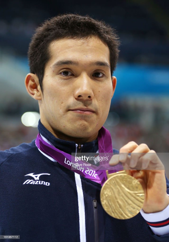 Gold medallist <a gi-track='captionPersonalityLinkClicked' href=/galleries/search?phrase=Yasuhiro+Tanaka+-+Swimmer&family=editorial&specificpeople=9697641 ng-click='$event.stopPropagation()'>Yasuhiro Tanaka</a> of Japan poses following the medal ceremony for the Men's 100m Breaststroke - SB14 finalon day 8 of the London 2012 Paralympic Games at Aquatics Centre on September 6, 2012 in London, England.