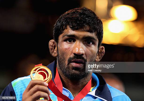 Gold medallist Yogeshwar Dutt of India poses during the medal ceremony for the Men's FS 65 kg at Scottish Exhibition and Conference Centre during day...