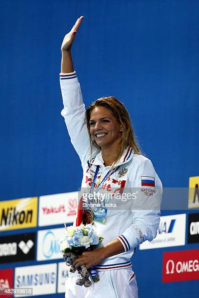 Gold medallist Yuliya Efimova of Russia celebrates during the medal ceremony for the Women's 100m Breaststroke Final on day eleven of the 16th FINA...