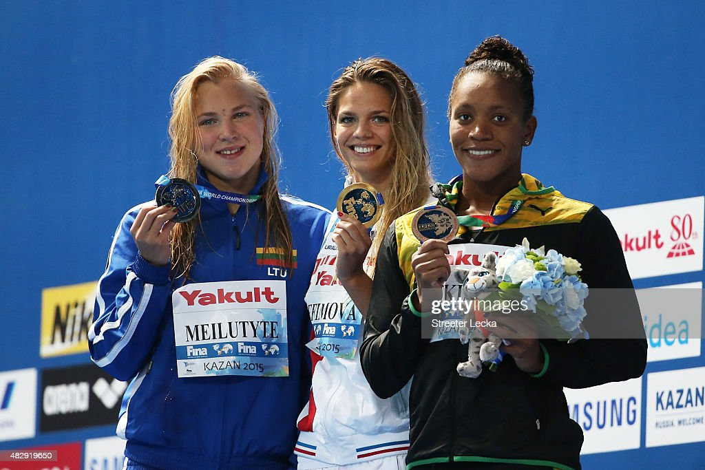 Gold medallist Yuliya Efimova of Russia poses with silver medallist <a gi-track='captionPersonalityLinkClicked' href=/galleries/search?phrase=Ruta+Meilutyte&family=editorial&specificpeople=7539009 ng-click='$event.stopPropagation()'>Ruta Meilutyte</a> of Lithuania and bronze medallist <a gi-track='captionPersonalityLinkClicked' href=/galleries/search?phrase=Alia+Atkinson&family=editorial&specificpeople=881789 ng-click='$event.stopPropagation()'>Alia Atkinson</a> of Jamaica during the medal ceremony for the Women's 100m Breaststroke Final on day eleven of the 16th FINA World Championships at the Kazan Arena on August 4, 2015 in Kazan, Russia.