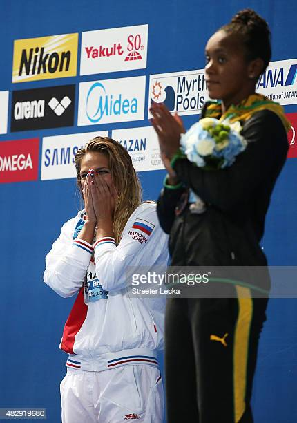 Gold medallist Yuliya Efimova of Russia reacts with bronze medallist Alia Atkinson of Jamaica during the medal ceremony for the Women's 100m...