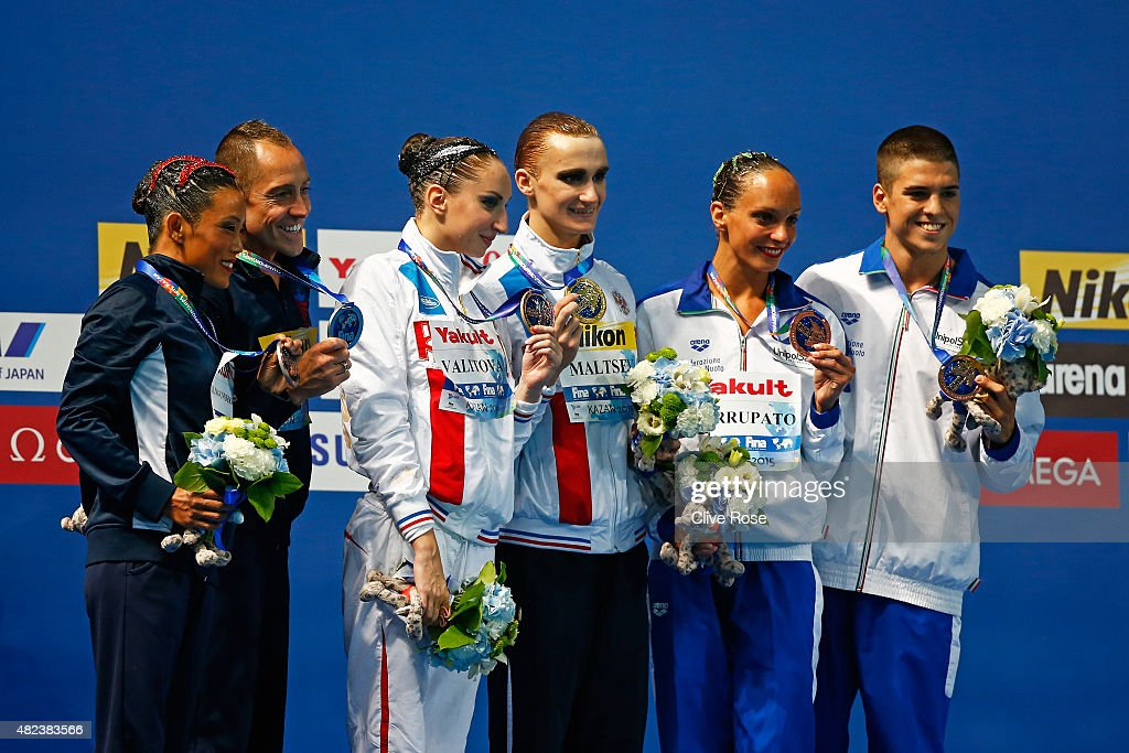 Gold medallists Aleksandr Maltsev and Darina Valitova of Russia pose with silver medallists Kristina Lum-Underwood and Bill May of the United States and bronze medallists Giorgio Minisini and Mariangela Perrupato of Italy during the medal ceremony in the Mixed Duet Free Synchronised Swimming Final on day six of the 16th FINA World Championships at the Kazan Arena on July 30, 2015 in Kazan, Russia.