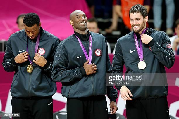 Gold medallists Andre Iguodala of the United States Kobe Bryant of the United States and Kevin Love of the United States celebrate on the podium...