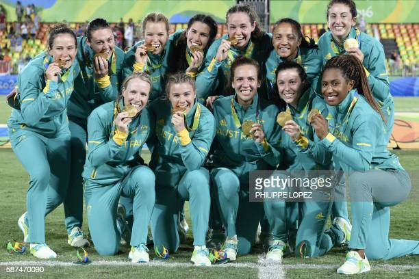 TOPSHOT Gold medallists Australia celebrate winning the womens rugby sevens tournament during the Rio 2016 Olympic Games at Deodoro Stadium in Rio de...
