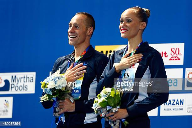 Gold medallists Bill May and Christina Jones of the United States celebrate during the medal ceremony for the Mixed Duet Technical Synchronised...
