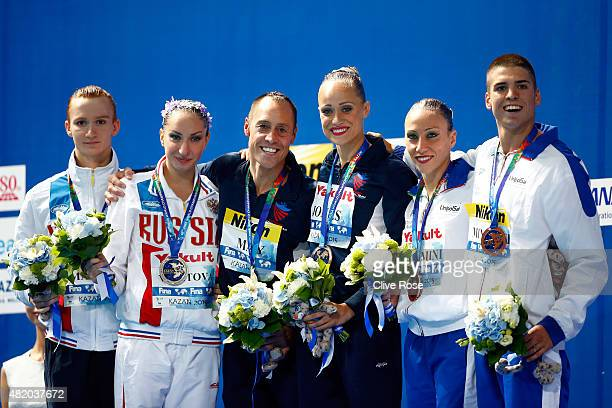 Gold medallists Bill May and Christina Jones of the United States pose with silver medallists Aleksandr Maltsev and Darina Valitova of Russia and...