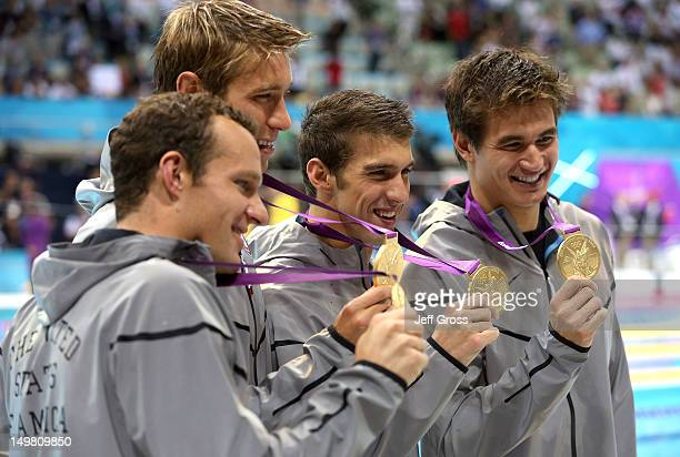 Gold medallists Brendan Hansen Matthew Grevers Michael Phelps and Nathan Adrian of the United States pose following the medal ceremony for the Men's...