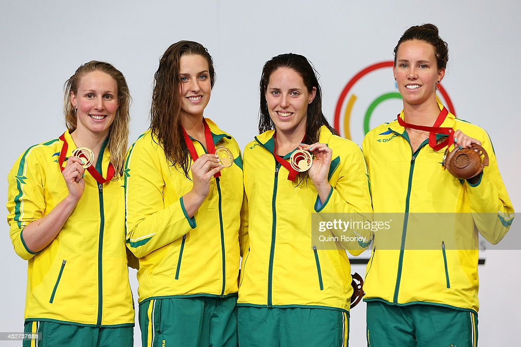 Gold medallists <a gi-track='captionPersonalityLinkClicked' href=/galleries/search?phrase=Bronte+Barratt&family=editorial&specificpeople=696848 ng-click='$event.stopPropagation()'>Bronte Barratt</a>, <a gi-track='captionPersonalityLinkClicked' href=/galleries/search?phrase=Brittany+Elmslie&family=editorial&specificpeople=9029839 ng-click='$event.stopPropagation()'>Brittany Elmslie</a>, <a gi-track='captionPersonalityLinkClicked' href=/galleries/search?phrase=Alicia+Coutts&family=editorial&specificpeople=2905127 ng-click='$event.stopPropagation()'>Alicia Coutts</a> and <a gi-track='captionPersonalityLinkClicked' href=/galleries/search?phrase=Emma+McKeon&family=editorial&specificpeople=7147243 ng-click='$event.stopPropagation()'>Emma McKeon</a> of Australia pose on the podium during the medal ceremony for the Women's 4 x 200m Freestyle Relay Final at Tollcross International Swimming Centre during day three of the Glasgow 2014 Commonwealth Games on July 26, 2014 in Glasgow, Scotland.