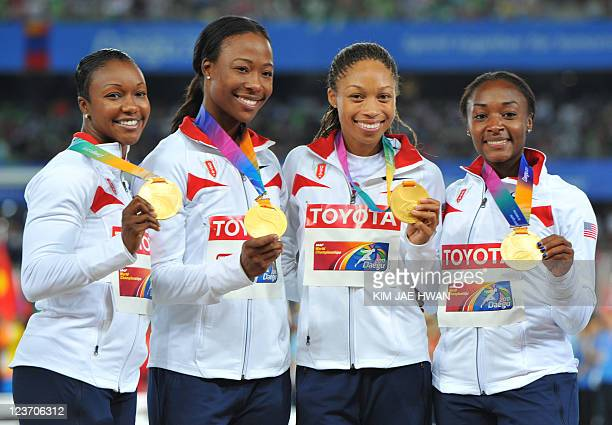 US Gold medallists Carmelita JeterMarshevet Myers Allyson Felix and Bianca Knight pose during the awards ceremony for the women's 4X100 metres relay...