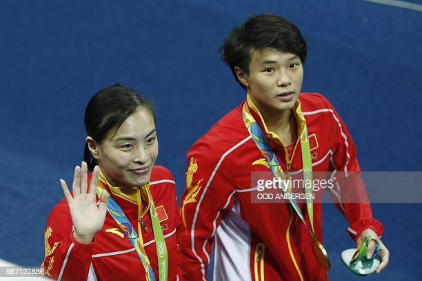 Gold medallists China's Wu Minxia and Shi Tingmao celebrate during the podium ceremony of the Women's Synchronized 3m Springboard final event at the...