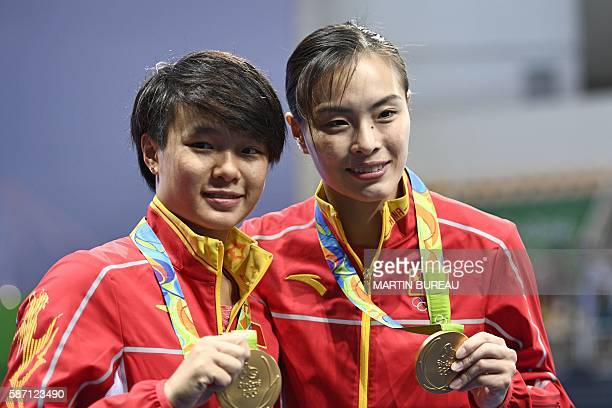Gold medallists China's Wu Minxia and Shi Tingmao pose during the podium ceremony of the Women's Synchronized 3m Springboard final event at the Rio...